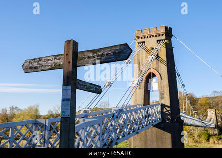 Southern Upland Way signpost by chainbridge footbridge across River Tweed near Melrose Scottish Borders Scotland - Stock Photo