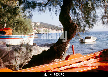 View of fishing boat overlooking village of Afissos in Pelion Peninsula, Greece - Stock Photo