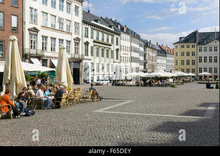 People sitting at cafe in Nytorv Square, Copenhagen, Denmark - Stock Photo