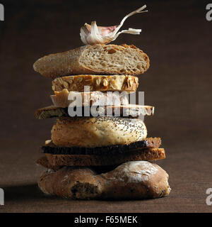 stacked assorted bread - Stock Photo