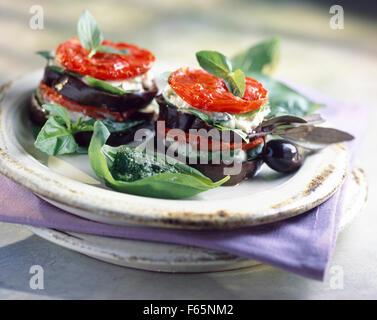 Eggplant,tomato and mozzarella Mille-feuille with pistou - Stock Photo
