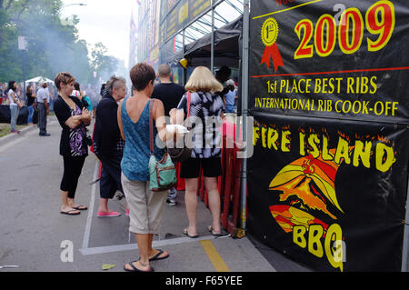 People queue to buy ribs at the annual Rib Fest held in London, Ontario. - Stock Photo