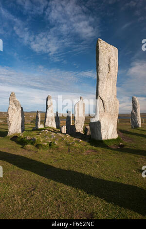 Looking SE at Callanish (Calanais) Standing Stones, Isle of Lewis, showing part of central ring with chambered cairn, - Stock Photo