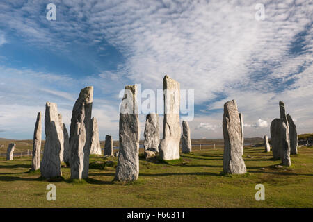 Looking SE at Callanish (Calanais) Standing Stones, Isle of Lewis: central ring with chambered cairn, tall monolith - Stock Photo