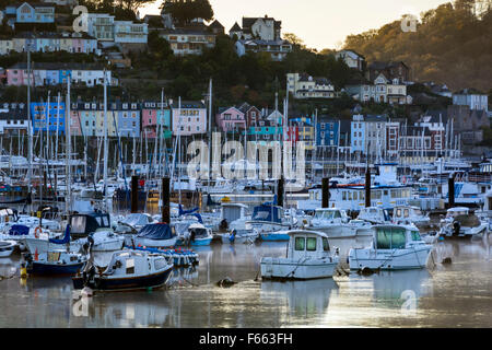 Early morning calm looking across the boats on the river Dart towards Kingswear. - Stock Photo
