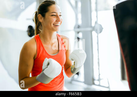 Young woman boxing and training in a gym - Stock Photo
