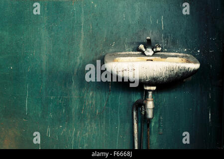 Old dirty sink in an abandoned factory. - Stock Photo