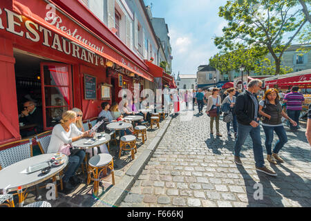 Restaurants and people on street in Montmartre, Paris, Ile-de-France, France - Stock Photo