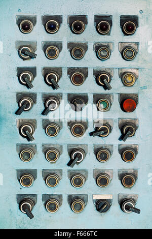Switches and buttons at an old abandoned factory. - Stock Photo