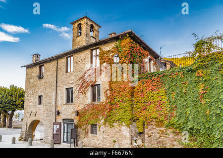 The Palace of the Captains in medieval mountain village in Tuscany characterized by houses with walls of stones - Stock Photo