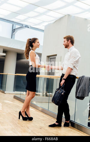Business people greeting each other formally - Stock Photo