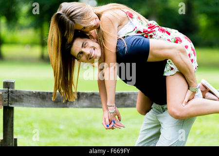 Happy couple in love having fun outdoors and smiling - Stock Photo