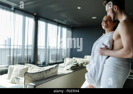 Couple in love relaxing in a wellness hotel with a beautiful panoramic view - Stock Photo