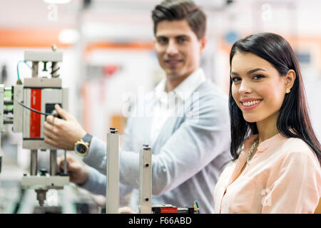 Two young students working on a science project together in lab - Stock Photo