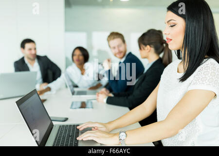 Businesswoman working on a laptop in an office during brainstorming - Stock Photo
