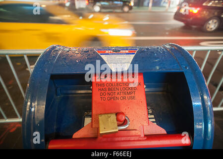 A USPS mailbox is locked for security purposes prior to the Veterans' Day Parade in New York, seen on Tuesday, November - Stock Photo