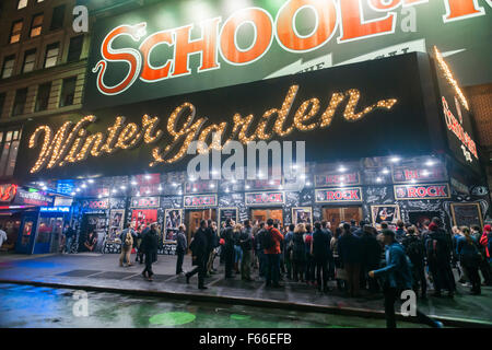 Theatre goers muster for rush tickets in front of the Winter Garden theater on Broadway in New York where the School - Stock Photo