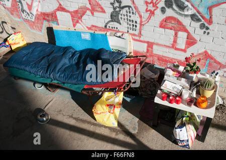 Set up for sleeping rough under a railway bridge in Berlin, Germany - Stock Photo