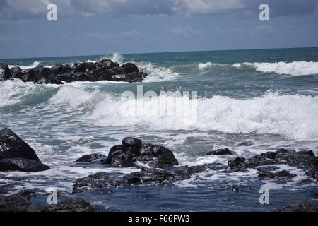 waves crashing on the rocks at Bundaberg, Queensland, Australia - Stock Photo