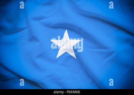 Wavy and rippled national flag of Somalia background. - Stock Photo
