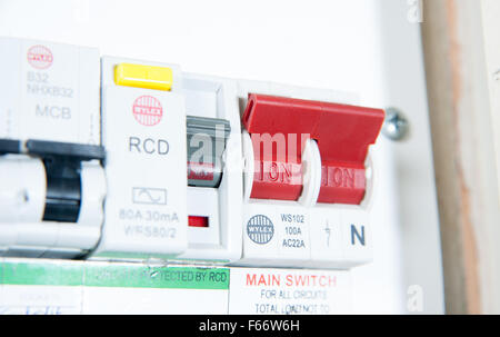 domestic home electrics main fuse box on off switch uk stock domestic home electrics main fuse box on off switch uk stock photo