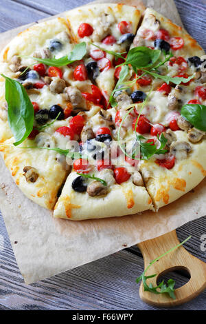 pizza with mushrooms and tomatoes, close-up - Stock Photo