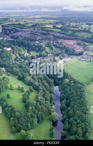 River Eden, edged by native woodland, winding through the countryside near Appleby, Cumbria, UK. - Stock Photo