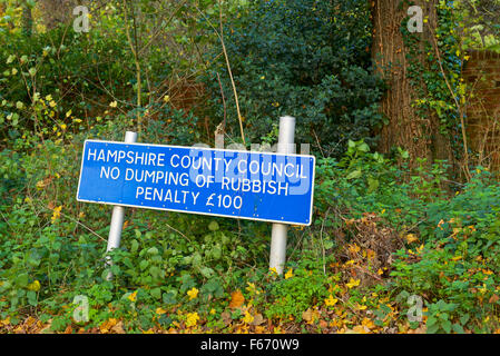 Sign erected by Hampshire County Council, no dumping of rubbish, England UK - Stock Photo