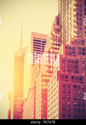 Vintage toned photo of skyscrapers in Manhattan at sunset, New York City, USA. - Stock Photo