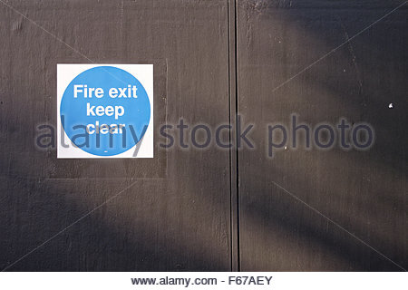 'Fire Exit Keep Clear' sign on door - Stock Photo