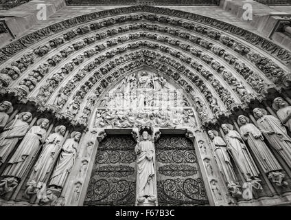 Central gothic portal of Notre Dame de Paris Cathedral featuring bas relief of the Last Judgement. Ile de la Cité, - Stock Photo