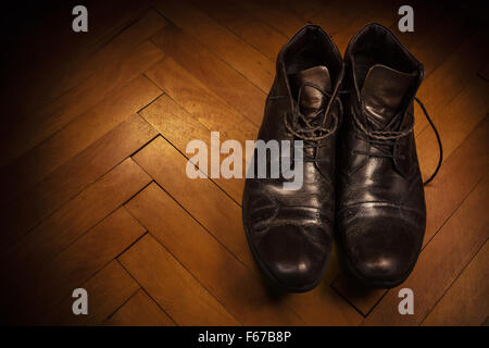 Male leather shoes on parquet, retro style. - Stock Photo