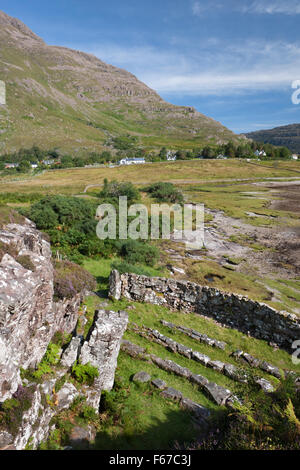 View E over stone pulpit, seating, entrance & enclosure wall of Am Ploc open air preaching site (1843) at head of - Stock Photo