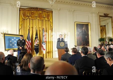 Washington, DC, USA. 12th Nov, 2015. U.S. President Barack Obama awards the Medal of Honor retired Army Capt. Florent - Stock Photo
