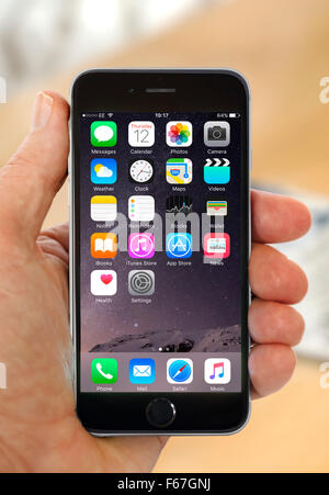 Default home screen on Apple iPhone 6 - Stock Photo