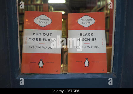 Hay on Wye, Powys, Wales -  second hand bookshops with novels by Evelyn Waugh in the shop window - Stock Photo