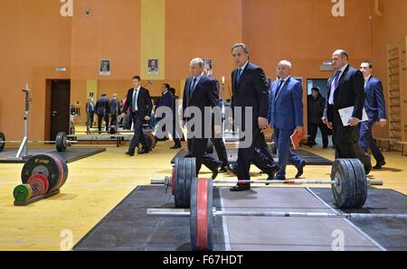 Russian President Vladimir Putin accompanied by Minister of Sport Vitaly Mutko during a visit to the Yug Sport Federal - Stock Photo