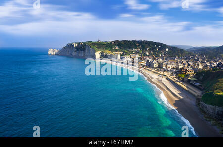 Falaise d'Amont cliff and Etretat city, Normandy, France - Stock Photo