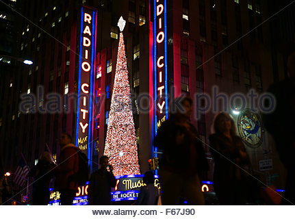 New York, USA. 12th Nov, 2015.  Christmas decorations on the exterior of Radio City Music Hall mark the beginning - Stock Photo