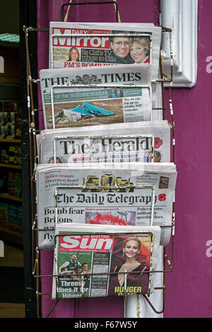 A selection of British newspapers outside a shop in Edinburgh, Scotland, UK. - Stock Photo
