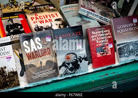 Books on war in the window of a charity bookshop in Edinburgh. - Stock Photo