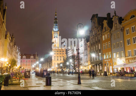 Long Market street and clock tower of city council by night. Gdansk, Poland - Stock Photo