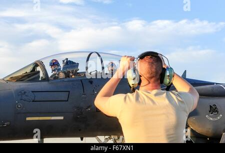 Incirlik Air Base, Adana, Turkey. November 12, 2015. US Air Force F-15 Strike Eagle fighter pilot follows taxi instructions - Stock Photo