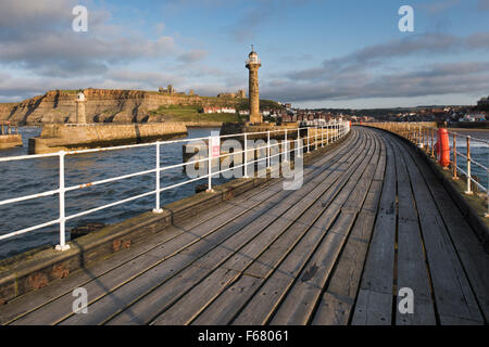 Scenic view of lighthouses, harbour entrance, West Pier, Abbey & St. Mary's Church on sunlit cliffs Summer evening, - Stock Photo