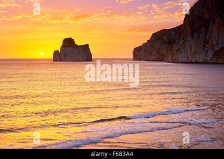 Pan di Zucchero at sunset time, Masua Village, Sardinia Island, Italy - Stock Photo