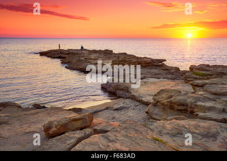 Sunset at the Riviera del Corallo, Sardinia Island, Italy - Stock Photo