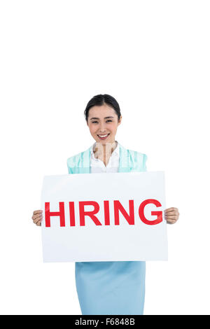 Businesswoman holding a hiring sign - Stock Photo