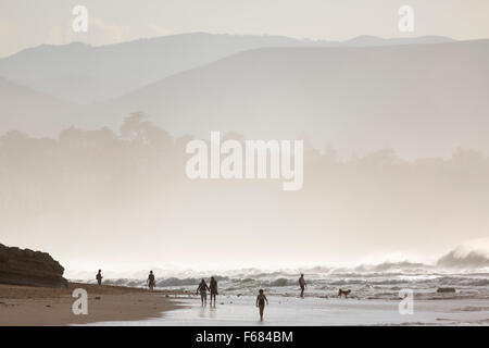 Walkers on the beach of Bidart in the late afternoon (France). Basque Country. - Stock Photo