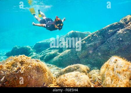 Woman snorkeling underwater, Costa Smeralda, Sardinia Island, Italy - Stock Photo