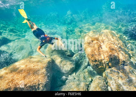 Woman snorkeling in the turquoise water, Punta dei Capriccioli, Costa Smeralda, Sardinia Island, Italy - Stock Photo